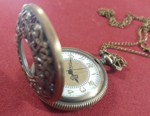 Pocket Watch - Brass face, Filagree adorned see-through lid